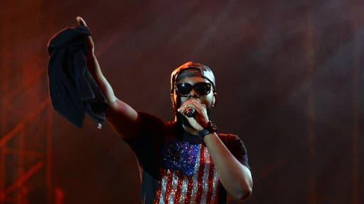 Le rappeur Maître Gims lors du concert Urban Peace 3 au Stade de France, à Saint-Denis, le 28 septembre 2013.