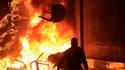 Le siège du Parti national démocrate (PND, au pouvoir) en feu au Caire. Selon des sources médicales, les affrontements dans la ville de Suez ont fait 13 morts et 75 morts vendredi. De même sources, le bilan à Alexandrie est de six morts et au Caire de 1.0