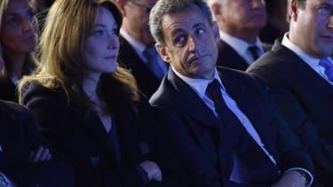 Nicolas Sarkozy et son épouse Carla Bruni lors d'un meeting pendant la campagne des primaires de la droite.