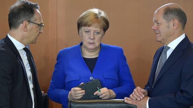La chancelière allemande Angela Merkel avec son ministre des Affaires étrangères Heiko Maas et son vice-chancelier Olaf Scholz, avant le conseil des ministres à Berlin, mardi 15 mai 2019 .