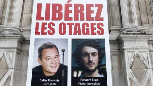 Portrait des journalistes Didier François et Edouard Elias à Paris le 6 septembre 2013.