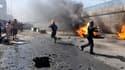 Une série d'attentats à la voiture piégée, ici à Nassiriah, et de fusillades, qui visaient manifestement la communauté chiite, a fait au moins 30 morts dimanche à travers l'Irak. /Photo prise le 16 juin 2013/REUTERS/