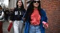 Des invités à un défilé pendant la Fashion Week