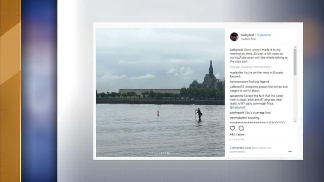 Scott Holt en train de traverser l'Hudson en paddle et costume, jeudi 21 juin 2018.