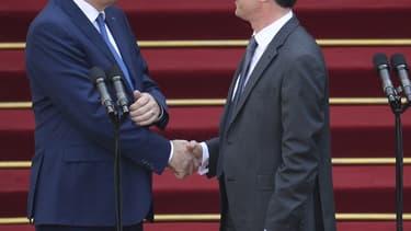 Jean-Marc Ayrault et Manuel Valls en avril 2014 quand le second a remplacé le premier à Matignon