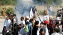 """Trois personnes au moins ont été tuées et 28 autres blessées vendredi dans des affrontements avec les forces de l'ordre autour de l'ambassade des Etats-Unis à Tunis par des manifestants dénonçant le film anti-islam """"L'innocence des musulmans"""", selon la té"""