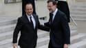 François Hollande accueillant le président du gouvernement espagnol Mariano Rajoy à l'Elysée. La garantie des dépôts bancaires doit être un principe absolu dans la résolution des crises financières, ont déclaré le président français et son homologue espag