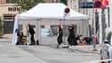 Des enquêteurs sur le lieu d'une explosion devant un commissariat de Copenhague, le 10 août 2019.