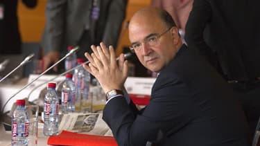 Le ministre de l'Economie et des Finances, Pierre Moscovici, a annoncé mardi la présentation à l'automne d'un projet de loi visant à mettre fin aux rémunérations jugées excessives dans le secteur privé en France. /Photo prise le 9 juillet 2012/REUTERS/Cha