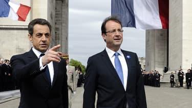 Nicolas Sarkozy et François Hollande lors de la cérémonie du 8-Mai à Paris, en 2012.