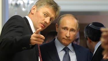 Le porte-parole Dmitry Peskov avec Vladimir Poutine, en 2013.