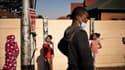 Des enfants portant des masques de protection en Afrique du Sud.