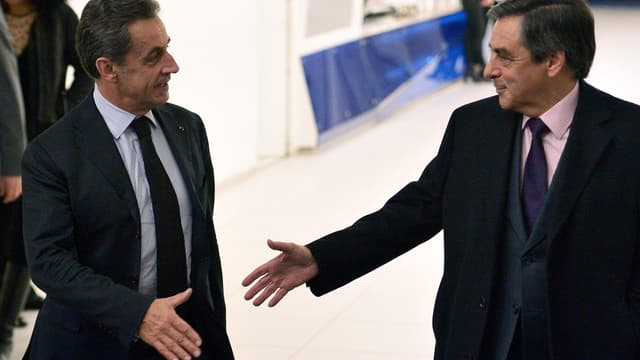 Nicolas Sarkozy et François Fillon au QG de l'UMP, rue de Vaugirard à Paris, le 2 décembre 2014.