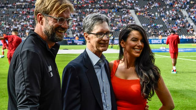 Jurgen Klopp avec le copropriétaire de Liverpool, John Henry, et sa femme