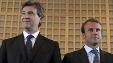 Arnaud Montebourg et Emmanuel Macron, lors de la passation de pouvoir à Bercy.
