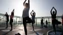 Une séance collective de yoga