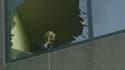 Prisonnier du WTC 7, en feu, un homme, appelle au secours.