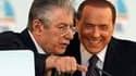 Silvio Berlusconi (à droite) et le chef de file de la Ligue du Nord, Umberto Bossi, lors d'un meeting électoral à Rome. La droite a repris quatre régions à la gauche lors des élections provinciales de dimanche et lundi, mais ces conquêtes profitent surtou