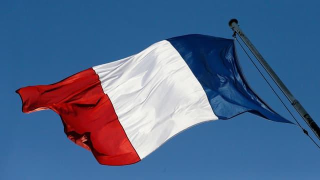 Le drapeau français flottant au-dessus du palais de l'Elysée, ici le 30 janvier 2013.
