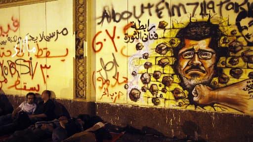 Un grafiti anti-Morsi, sur un mur du palais présidentiel au Caire.