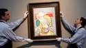 """""""La lecture"""" de Pablo Picasso, sensuel portrait de la maîtresse de l'artiste Marie-Thérèse Walter peint en 1932, est montré au public parisien depuis mercredi, avant sa vente aux enchères le mois prochain. /Photo prise le 19 janvier 2011/REUTERS/Benoît Te"""