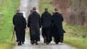 Des moines se rendant à l'abbaye de Fontgombault le 22 janvier 2014.