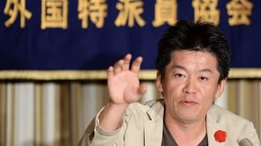L'homme d'affaires Takafumi Horie lors d'une conférence de presse à Tokyo en juin 2013 (archives)