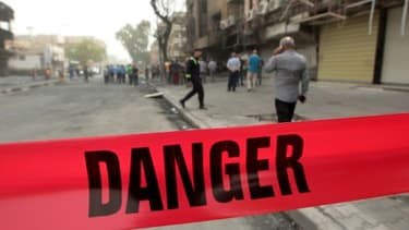 Un cordon de police déployé après une attaque, le 4 juillet 2016 à Bagdad