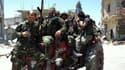 Des soldats de l'armée syrienne qui ont pris possession de la ville de Quoussir, le 5 juin 2013.