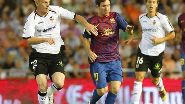 Jérémy Mathieu face à Lionel Messi