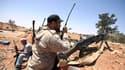 Rebelles libyens sur la ligne de front près de Misrata, dans l'ouest du pays. Les Occidentaux et les représentants de plusieurs pays arabes, réunis à Abou Dhabi, aux Emirats arabes unis, ont promis plus d'un milliard de dollars de financement aux insurgés