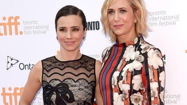 Linda Cardellini et Kristen Wiig, en septembre 2014 au festival du film de Toronto.