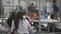 Les enfants séparés de leurs parents sont parqués dans des centres de détention.