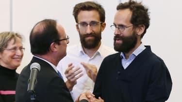 Tanguy et Cyril Moulin-Fournier, entourés de François Hollande