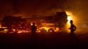 Un convoi de camions de l'Otan à destination de l'Afghanistan a été attaqué près d'Islamabad, la capitale pakistanaise. Sept personnes au moins ont été tuées et une cinquantaine de véhicules incendiés dans cette attaque, menée tard mardi soir./Photo prise