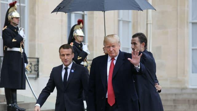 Emmanuel Macron et Donald Trump sous la pluie parisienne, le 10 novembre 2018