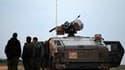 Troupes israéliennes stationnées au nord de la bande de Gaza. Deux soldats israéliens et deux Palestiniens armés ont été tués dans l'accrochage le plus meurtrier survenu à la frontière de la bande de Gaza depuis l'offensive israélienne de décembre 2008 et