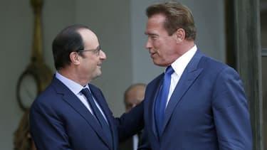 François Hollande et Arnold Schwarzenegger  à l'Elysée en 2014