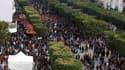"""Rassemblement avenue Bourguiba à Tunis. Les Tunisiens ont célébré samedi le premier anniversaire de la chute du président Zine ben Ali et du triomphe de la """"révolution du jasmin"""" qui a lancé le vaste mouvement du """"printemps arabe"""" en Afrique du Nord et au"""