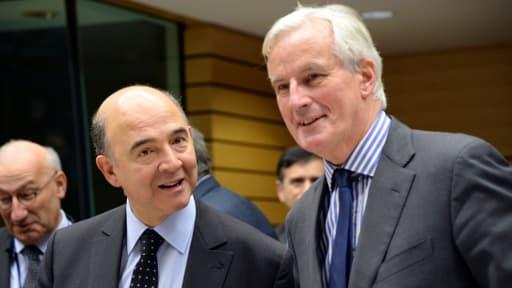 Pierre Moscovici et Michel Barnier, le 18 décembre 2013.