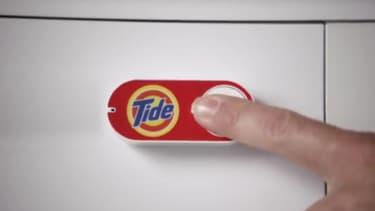 Une simple pression sur votre ce bouton accroché à votre lave-linge, et une commande de lessive est envoyée
