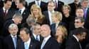 Le ministre des Affaires étrangères britanniques William Hague (au centre) entouré des particpants à la conférence de Londres sur la Libye. La coalition internationale a accentué la pression sur Mouammar Kadhafi en promettant de poursuivre ses opérations
