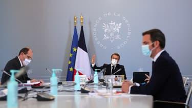 Emmanuel Macron, Jean Castex et Olivier Véran lors d'un Conseil de défense à l'Élysée le 12 novembre 2020.