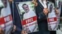 Des portraits de Jamal Khashoogi sont brandis devant le consulat d'Arabie saoudite à Istanbul, le 5 octobre 2018, lors d'une manifestation.