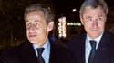 Nicolas Sarkozy avec son ex trésorier de campagne Philippe Briand (d.), à Tours le 17 décembre 2013.