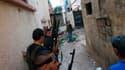 Dans le quartier à dominante sunnite de Bab al Tabbaneh à Tripoli, dans le nord du Liban. Des heurts entre sunnites et alaouites dans cette ville libanaise ont fait quatre morts et une soixantaine de blessés dans la nuit de lundi à mardi. /Photo prise le