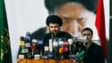 L'imam chiite irakien Moktada Sadr, rentré mercredi d'exil, a appelé samedi ses partisans à résister à tous les occupants présents en Irak et à s'opposer de ce fait aux Etats-Unis, mais pas nécessairement par les armes. /Photo prise le 8 janvier 2011/REUT