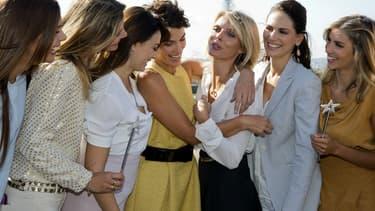 Sylvie Tellier entourée de plusieurs anciennes Miss France en 2015