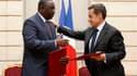 """A l'Elysée, Nicolas Sarkozy a annoncé mercredi l'octroi d'un crédit de 130 millions d'euros au Sénégal, une aide saluée comme un """"ballon d'oxygène"""" par le nouveau président Macky Sall qui effectuait sa première visite à Paris. /Photo prise le 18 avril 201"""