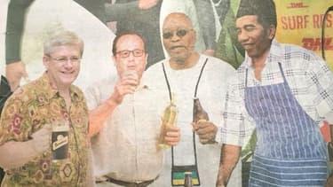 François Hollande sirote un verre de vin à la une d'un tabloïd australien, vendredi 14 novembre.